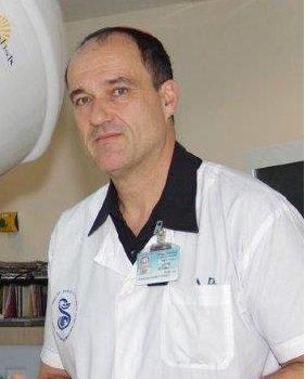 Доктор Цви Саймон
